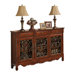 "Powell - Powell Walnut 3-Door Scroll Console X-533-642 - The ""Walnut"" finished Console is full of unique details that add instant drama and class to any room. The console opens with three doors and three drawers to reveal hidden storage space with interior, fixed shelf. The decorative curved bottom adds an extra touch of drama to the piece while the scroll details that adorn the front add an extra bit of interest. Scrolls are made of delicate reinforced cast resin faux metal grillwork in an antique, hand burnished, faux bronze finish. This is the perfect piece to add to any entryway, hall, bedroom, living area or dining area. Fully assembled"
