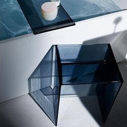 """Max-Beam Stool/Table by Kartell - Max-Beam Stool/Table by Kartell. A """"monolith"""" of a stool/small table made of transparent plastic and of modest size: its considerable thicknesses emphasise its geometric purity. A practical, functional and versatile accessory. Max-Beam Stool/Table by Kartell are designed by Ludovica and Roberto Palomba."""