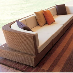Jerra Outdoor Wicker Sofa - The Jerra outdoor wicker sectional sofa has a right and left arm section, a center section and matching coffee table.