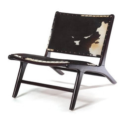 Chilin Chair - Rustic charm and minimalist style all in one piece. The Chillin Chair combines a mid-century wood frame with the earthy charm of a two-toned cow hide upholstered seat and back. It features an antique nailhead trim for additional detail and structure.