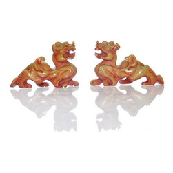 Pair of Stone Foo Dogs - Among the most powerful creatures in Chinese mythology, foo dogs make an impressive pair in hand carved green stone with painted red accents. Each pair varies slightly.