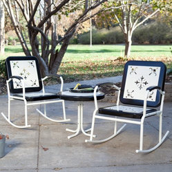 Paradise Cove Retro Metal Rocker Chat Set in Black - Have a rockin' good chat in the Paradise Cove Retro Metal Rocker Chat Set in Black. These two vintage-inspired rockers feature retro cutouts that bring a touch of antique style to any patio, while the table is a perfect companion. Each piece is crafted of durable steel for lasting longevity, and the black and white color scheme really creates a united sensibility. Chat!
