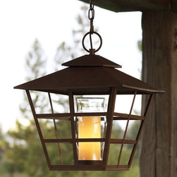Santa Maria Pendant | Pottery Barn - This lantern looks like a pillar candle, but it's actually a bulb! I love the classic lines of the lantern and the new take on the light that makes you look twice.