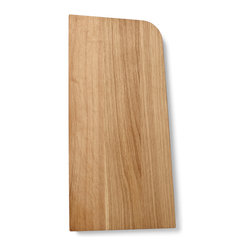 Menu - Tilt Cutting Board, Medium - Tilt Cutting Board is designed with a special angle on its sides in order for it to lean steadily against your kitchen wall. A clever detail that spares you the agony of cuts in the table top and loud slams of cutting boards hitting the table, while also adding a beautiful new dimension to the overall shape of the board - simple and straight lines broken by the soft iconic corners and perfectly angled sides. The cutting board is made of solid oak, treated with oil.