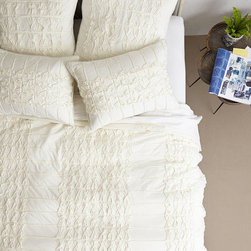Thayet Jersey Quilt - Folded at the foot of the bed, or sprawled atop a cozy respite, this tucked-and-gathered quilt has an easy elegance that's feminine without being too saccharine.