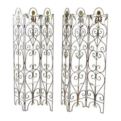Pre-owned Vintage Scrolled Iron Screens - A Pair - Put these in the Conservatory! Or in your breakfast room and pretend you have a conservatory. They'll add garden feel to any room, or interest to any garden. You could attach them to a blank exterior wall and add intriguing texture.     Graceful arabesques of iron with a few leaves and flowers. There is a bit of faded gilt decoration - more on one than the other, and one has a few more leaf pieces than the other. Vintage pieces, made of iron, these screens are very heavy (90 lbs each).  (If you use them outside they are likely to rust, unless you add a protective paint.)     Unusual garden style accent -- evocative of Europe.