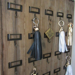 Vintage Hotel Key Rack Provides Modern Convenience - Vintage Wooden Hotel Key Rack  from Vagabond Vintage features 20 metal hooks with name plates. Distressed, reclaimed wood varies per piece making each a one of a kind.