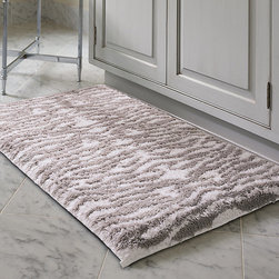 """Frontgate - Cleo Removable Memory Foam Rug - """"Easy care"""" removable memory foam insert allows for much faster drying time than traditional memory foam rugs. Design inspired by a natural zebra hide. 16 mm-thick memory foam insert provides cushioned comfort and anti-fatigue benefits. 50% combed cotton and 50% micropolyester. Total rug thickness: 1.6"""". With the Cleo Removable Memory Foam Rug, untold comfort awaits atop the ultraplush pile with a realistic zebra-hide pattern. The 16 mm-thick insert, protected by a water-repellent polyester fabric, removes for easy cleaning and quick drying. The cotton-poly rug, combed to 2,200 grams per square meter, adds dimension to the bath.  .  .  .  .  . Plush, tufted pile . Skid-resistant backing provides secure footing . Machine wash . Made in Portugal."""