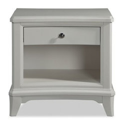 Whitley 1 Drawer Nightstand - Soft Designer Gray - The charming, compact look of the Whitley 1 Drawer Nightstand - Soft Designer Gray make it the perfect bedside companion in your well-appointed room. Clean lines and sweet details like flared legs and apron detail make this the perfect addition to the Whitley collection. The soft designer gray finish adds a dreamy quality, and simply begs for a stylish lamp on top. One drawer provides just enough storage to stash bedside items for convenience without clutter, while the open shelf below is perfect for displaying favorite books and accessories.About Magnussen FurnitureFrom its beginning as a small furniture company in Ontario, Canada, Magnussen Furniture has evolved into a full-line furniture resource with offices in Canada, the United States, and the Far East. Their business is creating furniture designs of exceptional style, value, and beauty. They produce these designs in partnership with manufacturing partners around the world that meet exacting standards for superior quality at the best possible value.