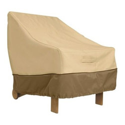 Classic Accessories Adirondack Chair Cover - Pebble - You finally got that Adirondack chair you've always wanted. Make sure it stays perfect by protecting it with the Adirondack Chair Cover - Pebble. This handsome cover is designed to cover your classic Adirondack chair with a customized fit. Click-close buckles and an elastic hem cord with adjustable toggle keep it on securely. Padded handles make removal a breeze while air vents reduce condensation. This cover is made of weather-resistant polyester fabric with PVC backing and comes in pebble with a sage border. About Classic AccessoriesFounded from small beginnings, Classic Accessories has grown in the past 30 years from a small basement operation in Seattle's Roosevelt neighborhood making seatbelt pads and steering wheel covers, to a successful and expanding company now making a wide variety of products from car to boat covers and much more. Innovative, stylish designs define products that are functional and made to last. From little details to the largest innovations, Classic Accessories is always moving forward and looking to provide cover and storage solutions to a clientele that has a passion for the outdoors, from backyard gatherings to exciting camping trips, Classic Accessories provides the products that keeps your equipment looking great all season long.