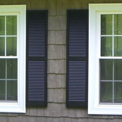 Double Hung Windows - These mirrored double hung windows each have half screens installed.  When either the top or the bottom half of the windows are opened the screens can be slid up or down to keep out the bugs.