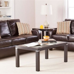 Southern Enterprises - Braxton Sofa and Loveseat - Includes 1 sofa, 1 loveseat, and 4 toss pillows. Chocolate bonded leather with espresso legs. Toss pillows feature one side in chocolate and one side with link pattern. Constructed of 100% hardwood base and bonded leather. Cushions are made of 1.8 density CA foam, memory foam, and recycled blown polyester fiber. Assembly required; five minutes or fewer. Loveseat: 52.5 in. W x 33.5 in. D x 35 in. H, seat: 41.5 in. W x 20 in. D x 19 in. H. Sofa: 72.5 in. W x 34 in. D x 35 in. H, seat: 62 in. W x 20 in. D x 19 in. H. Space under furniture: 3.25 in. H. Cushions: 6 in. THK (bottom), 8 in. THK (back); cushions are stitched in place and are not removable. Toss pillows: 16 in. W x 16 in. D Inspire your family with a room you'll enjoy spending time in by starting with the right foundation: a comfortable, beautiful sofa set. The luxury and exquisiteness of this sofa and love seat are sure to be the highlight of the room and envy of your guests. This sofa set features gorgeous chocolate bonded leather, which offers the look and feel of luxury without the price tag. The scooped arms provide both design and comfort, while the sides feature lovely stitching details. This sofa set is easy to assemble, making it the perfect choice for any home. In approximately five minutes, you can assemble this sofa set without any tools or formal training. This sofa set features an easy to assemble design which utilizing connecting brackets and allows you to simply click each into place. The ease of assembly isn't only an advantage when you first purchase this sofa and loveseat. disassembling and reassembling is a breeze for stress-free moving or rearranging. This sofa set complements homes with transitional to modern decor. Add this sofa and loveseat to your living room or family room today!