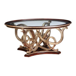 Marge Carson - Marge Carson Bossa Nova Cocktail Table - Marge Carson Bossa Nova cocktail table is shown in the signature wood contemporary hazelnut finish,  with a contrasting sculptured base in the Versailles metal leaf.  This item is an obvious piece of art and would define any room.  This transitional piece measures 52 inches in diameter and is 23.5 inches tall.   Marge Carson is a high end vendor.  Due to the extensive steps involved in creating these luxury finishes, the detailing and quality control, this item ships in 8-10 weeks.  This item is a non cancellable purchase.