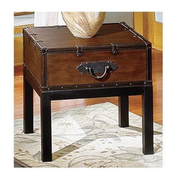 Steve Silver Co. - Voyage Trunk End Table w Metal Pull in Rich C - Trunk style end table in a rectangle shape. Sitting atop square legs this trunk has a leather like finish. Nail head trim around the edges. Decorative leather like trim & straps with metal pulls on the front. Multi-step Antique Cherry finish. Traditional style. Corner block construction. Tongue and groove joints. Select hardwood solids material. Some assembly required. Select hardwood solids material. 24 in. L x 20 in. W x 24 in. H (44.5 lbs.)