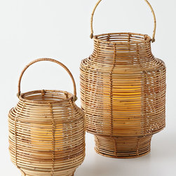 Rattan Lantern - Add a couple of outdoor lanterns on the steps leading up to your front door, or scatter some on the front porch for the perfect touch.