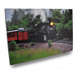 Zeckos - Flickering LED Steam Engine Train Scene Canvas Wall Hanging - This amazing canvas depicts a steam powered train chugging around a bend. It features a flickering LED headlight that really makes it shine It measures 12 inches tall, 18 inches across and 3/4 inch deep. It easily hangs on the wall using a single nail or screw. The flickering light is powered by 2 'AA' batteries (not included), are controlled by an inconspicuous on/off switch on the side of the canvas, and unsightly wires are concealed and contained by the vinyl backing. This piece would add excitement to the walls of any office, library or gathering room, and makes a great gift for train enthusiasts