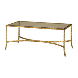 "Currey & Co - Currey & Co 4057 Gilt Twist Gilt Bronze Table - Taken from the ""Currey in a Hurry Collection"", the Currey & Co 4057 Gilt Twist Gilt Bronze Table emulates the mid-20th century furniture style that made both Gilbert Poillerat and Maison Jansen famous. Sporting a gold leaf finish on an elegant glass top, this table can be used for coffee in your living room or it can serve a more decorative function in other rooms. The quiet sophistication of the Gilt Bronze table makes it useful in a wide range of interior decorating styles. Dimensions: 44"" width x 18"" height x 21"" depth."