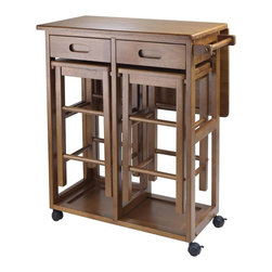 Winsome Wood - 3-Pc Space Saver Pub Table Set - Includes drop leaf table and two stools. Two drawers. Wheels for easy transport. Stools can be stored on the cart. Made from solid and composite wood. Teak finish. Assembly required. Stool: 11.4 in. W x 11.4 in. D x 20.8 in. H. Table: 29.61 in. L x 29.13 in. W x 32.76 in. HUse it in the kitchen or out on the patio for an effortless outdoor meal.