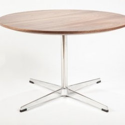 Gennep Round Coffee Table - The Gennep coffee table provides a large round surface with a rich walnut veneer. The table top is supported by a stainless steel frame with a polished aluminum base.