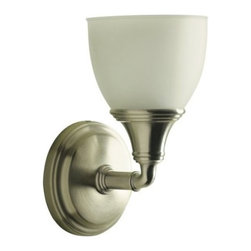 "KOHLER - KOHLER K-10570-BN Devonshire Single Wall Sconce in Brushed Nickel - KOHLER K-10570-BN Devonshire Single Wall Sconce in Brushed NickelFeaturing an elegant combination of curves and gentle lines, Devonshire(R) accessories add refinement to any bath or powder room. This UL and CUL approved single light sconce, offered in a wide array of lustrous finish options, is designed to fit with KOHLER(R) mirrored bath cabinets and complements the Devonshire Suite of products.KOHLER K-10570-BN Devonshire Single Wall Sconce in Brushed Nickel, Features:• 4-15/16""W x 6""D x 9-1/8""H"