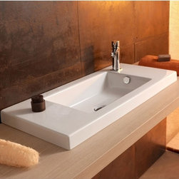 Tecla - Rectangular White Ceramic Wall Mounted, Vessel, or Built-In Sink - Modern style rectangular white ceramic wash basin with overflow. Impressive bathroom sink can be wall mounted, above counter, or vanity. Available with no hole or one hole. Made in Italy by Tecla. Rectangular white ceramic sink. Wall mount, vessel, or drop-in. With overflow. ADA compliant. No hole or one hole. From the Tecla Serie 35 Collection. Standard drain size of 1.25 inches. Because the sink has multiple installations, the back side is not glazed.