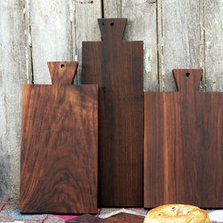 Walnut Serving Board by Cattails Woodwork - Angular edges and deep brown grains sure do make a beautiful cutting board. String some leather through the hole and hang when not in use for a beautiful display in your kitchen.