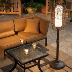 Bristol Outdoor Patio Floor Lamp - What a unique lamp! I dig the random weave of the wicker shade.