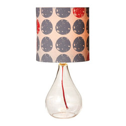 Sweet Spot Lamp - Personality is no problem for this modern, yet subtly retro table lamp. The red cord visible from inside the clear glass base matches the scattered red dots that appear on the shade.