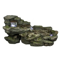 YOSEMITE HOME DECOR - Cascading Rock Fountain - This multi-level fountain has a peaceful flow of water traveling horizontally down what appears to be natural moss-covered stone.  Each small basin the water encounters is illuminated with LED lighting.  This polyresin fountain is indoor and outdoor rated.