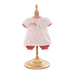 Corolle Mon Classiques Bebe 14 in. Bloomer Happiness Doll Ensemble - Your little one's Corolle Mon Bebe Classiques dolly will be dressed up cute in the Corolle Mon Classiques Bebe 14 in. Bloomer Happiness Doll Ensemble. This beautifully sewn and finished ensemble includes a white flower-print dress with adorable coordinating bloomers. This outfit is designed to fit her 14-inch baby doll.About CorolleCorolle is a premier doll brand designed in the storybook region of France's Loire Valley. Since 1979, Corolle has been creating highly detailed dolls designed to be cherished by children everywhere. Every Corolle doll will inspire magical childhood memories that will last for a lifetime. Corolle dolls look and feel as real as possible. They're created of soft, supple vinyl, have natural-looking hair, and wear on-trend fashions. Corolle dolls are designed durable enough to withstand years of hugs and love. Perfect heirloom treasures! Doll play encourages children to explore different roles from caring for and sharing hopes and dreams to finding an understanding playmate and friend for life. Corolle designs dolls for children of all ages.There is a range of Corolle dolls designed for specific ages. Babi Corolle is a soft-body doll perfect for newborn babies and older. It's machine-washable, feather-light, and made to be loved. Mon Premier Corolle is designed for babies 18 months and older. This line includes a range of baby dolls, clothing, and accessories. The dolls are lightweight and soft. The clothing has Velcro closures so it's easy to put on and take off. Mon Classique Corolle is a classic baby doll designed for toddlers to love and nurture. This line has a complete assortment of larger baby dolls, clothing, and nursery accessories. Some even have hair that can be brushed and styled. Others coo, giggle, drink, and go potty. Mademoiselle Corolle is a toddler doll for toddlers. These dolls have expressive faces, silky long hair, and are dressed in the latest styles. This doll will be your little one's best friend. She's perfect for sharing secrets and working out new hairstyles and fashion. Les Cheries Corolle is designed for little ones four years and older. She has long, lush, rooted hair and an amazing wardrobe of stylish outfits. This doll provides endless hours of fashion and hair play.