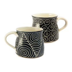 Vuyisa Potina - Sabelo Swirl and Circle Coffee Cups – Set of 2 - These beautiful hand-thrown stoneware coffee cups are a great way to start the day.  Named Sabelo, which is the Xhosa word for share, we hope you enjoy them with loved ones. One is dotted with double circles, the other with a swirl pattern, accented by a black glaze.  Both the interior and exterior of each is covered in a clear glaze; making them food-safe, dishwasher and microwave safe.  Vuyisa personally crafts each piece, ensuring that no two are exactly alike.