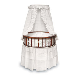 Badger Basket - Cherry Elegance Round Baby Bassinet - White Eyelet Bedding - The Elegance Bassinet is the most charming and unique place for your newborn to sleep! This special oval bassinet with a cherry finish is comfortable for Baby and stylish for your home. White Eyelet bedding set (with Ecru Waffle pleats and trim) includes a lovely pleated skirt, soft bumper, fitted sheet, and drape canopy and a custom fitted, vinyl covered foam mattress pad. Also includes caster wheels and storage shelf beneath. The Elite Bassinet can be used for infants up to 20 lbs or until Baby can push up/roll over. Easy assembly with illustrated instructions. Manufacturer: Badger Basket. Brand: Badger Basket. Part Number: 00829. UPC: 46605188293