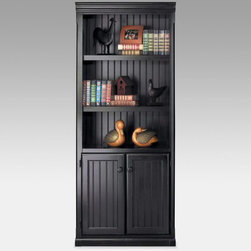 Martin Home Furnishings - kathy ireland Home by Martin Southampton Wood Bookcase with Doors - Black - SO30 - Shop for Bookcases from Hayneedle.com! The kathy ireland Southampton Wood Bookcase with Doors - Black adds a touch of modernity to a time-tested New England style. Beauty lies in minute details that create a sleek aesthetic: vertical slat molding inlaid doors and distressed finishing. Constructed from hardwood solids and veneers this bookcase welcomes rigorous use. Three adjustable and two fixed-height shelves offer arrangement flexibility to dynamic decorators. Fully assembled for convenience and immediate use.Take comfort in a 10-year manufacturer's warranty offered by Martin Furniture.About kathy ireland Home by Martin FurnitureA well-known industry-leading manufacturer of home office and home entertainment furniture kathy ireland Home by Martin exemplifies kathy ireland's mission statement: Finding solutions for families especially busy moms. As Chief Designer Kathy collaborates with kathy ireland Home by Martin and kathy ireland Office by Martin on the design and marketing of each and every furniture collection. Each collection is designed and constructed with four words in mind: fashion quality value and safety.About Martin FurnitureMartin Furniture was founded in 1980 by Gil Martin in the San Diego suburb of El Cajon. Martin started the company in his garage with $400 a Craftsman table saw and the business knowledge he gained from working for defense contractor General Dynamics. Today Martin Furniture specializes in American-made and imported office and home entertainment furniture. In 2003 it teamed up with kathy ireland's design company kathy ireland Home creating furniture solutions for families. Boasting solid growth in sales over the past 25 years Martin Furniture's success can also be measured by the satisfaction of its customers. Its operation now includes among other resources a 250 000 square-foot facility in San Diego. In addition to the bookshelves found here Martin has a vast collection of flooring rugs lighting wall art accessories home office and general home furniture for all budgets.