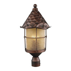 """3 Light 26"""" Post Lantern w Amber Seedy Glass - Add some storybook flair to your home with this wonderful post light design. Perfect for settings as varied as an Old English cottage or a Spanish Revival home, the light comes features hand-hammered iron and an antique copper finish. Three lights set behind amber scavo glass offer plenty of light."""