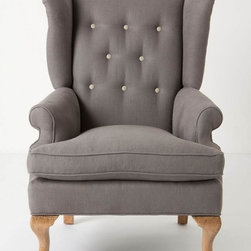 Howell Wingback, Linen - This traditional wingback chair has a funky and modern twist with the exaggerated wing tips.