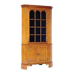 Eldred Wheeler - Corner Cupboard with Glass Door in Tiger Maple - Commonly built into the corner of a dining room, a corner cupboard was often an architectural extension of the home. This freestanding cupboard, which was copied from a piece found in Connecticut, features full shelves to maximize interior storage space. The door is comprised of 12 panes of high quality antique reproduction glass with the three top panes being arched.