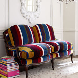 """Patch-Stripe Settee - Filled with bright, beautiful color, the Patch-Stripe Setteeis upholstered in a series of brilliant stripes, each a different fabric. This sette, crafted in Italy of European beech wood, is finished with """"wormholes"""" for a vintage look. 67""""L x 38""""D x 39""""T overall."""