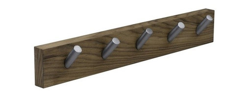 """Desiron - Coat Hanger - Keep messes from piling up near the door with the classic and chic Coat Hanger. Finished in your choice of natural or dark walnut, this coat hanger will be the perfect addition in your entryway and will keep all of your items organized and tidy. This coat hanger can be easily mounted to your wall with a hidden """"french cleat"""" for a clean hanging. Features: -Natural and Dark Walnut finishes -Solid walnut veneer construction -5 matte steel pegs -Made in the USA -Overall Dimensions: 4"""" H x 26"""" W x 1.5"""" D Order with Confidence: -Desiron's pieces are meant to be used, so let the kids jump on it and your friends and pets lounge on it. Let yourself unwind on it because Desiron pieces can take it all and more. Every piece is hand crafted by talented artisans using domestic materials. -Desiron's pieces have long been a favorite of the trade magazines and have been featured in Vogue, Details, W, Elle D�cor, New York Magazine, InStyleHome, on Queer Eye for the Straight Guy, and in many other publications and programs around the world. -All woods are certified from sustainable forests making Desiron ecologically conscious. -Color, grain variations, and veining are natural characteristics of steel, wood, and leather and will differ from piece to piece. -All dimensions are subject to a tolerance of + or - .75"""" in any given direction."""