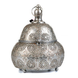 "Concepts Life - Concepts Life Candle Holder  Luminous Lace Lantern  Silver, Medium - Whether you are preparing for a special occasion or simply want to make a strong statement in your home, our Luminous Lace collection will instantly infuse elegance into your space. Our silver lanterns have ornate details on the surface and beautiful perforated patterns that will let the light from within add warmth and sparkle to any occasion. This magnificent pear shaped medium sized lantern comes with an interior glass cup to keep the flame governed. Scent and light eminate form the intricate carvings and are secured by the hand welded retractable top. Complete with a top loop for easy transport onto any surface or for simple hanging nearby. The electroplated finishing process garantees long lasting briliance to this strong, ornately crafted iron piece.  Hand welded from 100% iron Opens via clasp and hinge Includes glass cup for a votive or tealight candle Complete with hanging chain and S hook Beautifully hand-crafted; will have unique bends and asymmetries Dimensions: 7.5""w x 10""h x 7.5""d style=""font-size: x-small Weight: 1 lbs Available in larger size"