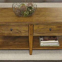 None - Liberty Lake House Transitional Oak Cocktail Table - The Liberty cocktail table from the Lake House Collection combines the durability of oak and sharpness of antique brass to create something worth passing down. The pull-out drawers and lower shelves are perfect for books,paperwork or decorative items.