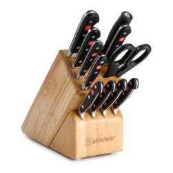 """Wusthof - Wusthof Classic Twelve Piece Block Set - Wusthof Classic knives are forged from one piece of specially tempered high carbon steel to ensure outstanding strength. Extraordinary sharpness which is easy to maintain. Special alloyed stainless-steel. Seamless, hygienic fit of the handle. Triple-riveted handle shells, full tang handle. Black handles made of synthetic material. For professional chefs and home cooking enthusiasts. Long-lasting extreme sharpness, thanks to PEtec - WÜSTHOFs Precision Edge Technology. Made in Germany. Set includes 3.5"""" Paring knife, 6"""" Utility knife, 8"""" Carving knife, 8"""" Bread knife, 8"""" Cook's knife, four 4.5"""" steak knives, 9"""" Sharpening Steel, Kitchen Shears and a 13-slot storage block. Made in Germany."""