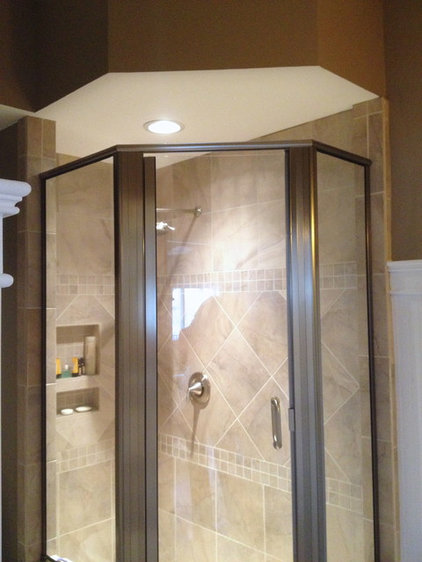 Eclectic Showers by Total Quality Home Builders, Inc.