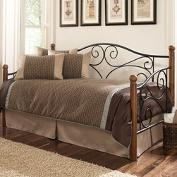 Fashion Bed Group - Doral Matte Black/Walnut Daybed - With its clean design of scrolled metal spindles and round solid hardwood posts, the Doral Daybed can be easily paired with most interior decor design styles. The grills, finished in matte black, borrow from rustic Tuscan farmhouse decor, but could also easily improve upon modern or traditional decor. The walnut finished hardwood posts are topped with carved finials that, coupled with the simple elegance of the scrolled spindles, create a sturdy yet quaint look for your space. Mattress, link-spring and pop-up unit are not included but are available for purchase.