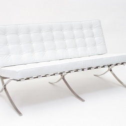 "IFN Modern - Barcelona Style Loveseat - Italian Leather, White - Our Barcelona Reproduction loveseat is a perfect complement for the rest of our Barcelona Reproduction collection. This design is inspired by Mies Van Der Rohe and Lilly Reich whom displayed their products to the world at the German Barcelona Reproduction for the 1929 exhibition. The Barcelona Reproduction loveseat is perfect for condominiums, reception seating, and other seating where a full sofa would be too large.                                                                                                                                                                                                                                                                       Overall Dimensions: 31.5"" H x 51.1"" W x 31.5"" D"