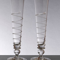 Pair of Amalia Flutes - Striking high style in wedding gifts, sublime glassware on the table � the elegant Pair of Amalia Flutes provides a matched set of a versatile transitional design, made from clear glass with a graceful spiral around the tapering high cup of the clear champagne flute.  The beautiful stem, inspired by hefty turned spindles, lends a handsome artisan impression to the airiness of the design.