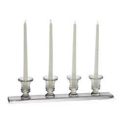 Linear Candleholder - Stylish Linear Candleholders designed to give your space an exquisite look with extra gleaming effect of candle light. This wonderful art piece is designed with four candle holders over a flat linear surface. This set of candleholders has given a hand-blown finish that can hold the attention of every visitor. This linear candleholder gives a reflection of your sophisticated taste and lifestyle. You can add this to the decoration of a perfect candle light dinner with your loved one. This alluring piece can change the ambience around you with its aesthetic charm. Even its best to give a sophisticated look to your table tops.