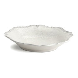 Merletto Antique Scalloped Pasta/Soup Bowl - The edges of the Merletto Antique Scalloped Pasta and Soup Bowl have a fair complexity that elevates your table setting, bringing an air of uptown grace to make your overall look unique and unexpectedly elegant. Inside the scalloped rim, a soft floral lace pattern with a delicate heirloom look adds a measure of tone-on-tone glamor to the traditional dining room.