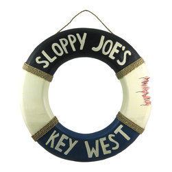 Zeckos - Sloppy Joe`s Key West Life Preserver Wooden Wall Hanging - This awesome Sloppy`s Joe`s Key West life ring wall hanging is hand-carved from dark Indonesian Albessia wood, and is hand-painted. Measuring 21 1/2 inches in diameter and 1 1/2 inches deep, the life ring looks like a shark has bitten a chunk out of the side. It looks great on walls in patios, tiki bars, pools, even in bedrooms.  It makes a great gift for anyone who loves Key West. NOTE: Since these are hand carved and hand painted , there may be slight color or design differences from the pictures.