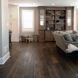 Barrington Residence - This Smoked Black Oak wide plank hardwood flooring, which is now being offered among our many collections, is a unique wood with many stunning features. These individual features, ranging from the deep and traditional color to the high level of work that goes into the creation of this product, differentiate it from much of the other flooring that is sold. As a result of the natural smoking process that the Oak undergoes, not only does the wood become more stable, but the grain of the wood becomes lighter than the wood itself. This stunning feature is the reverse product of staining, making the Black Smoked Oak flooring very distinctive.