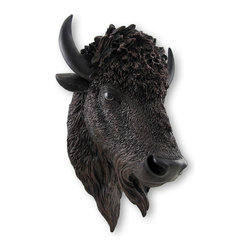 Zeckos - Realistic American Bison Head Statue Wall Mount - Despite their massive size, bison are actually quick on their feet, and can run at speeds up to 40 miles an hour This formidable beast will add presence to your walls and adds a touch of western exotic that is sure to be noticed This wall mounted bison head is a great addition to your trophy collection, or a great way to start one Made of poly-stone, this magnificent horned animal is 18 inches high, 12 inches wide and 10 inches deep and easily hangs on the wall using a single nail or screw via the attached keyhole hanger on the back. This wonderfully hand-painted black and brown bison statue boasts windblown hair and realistic eyes perfect for hanging in a 'man cave', to grace the walls of a family room, watch over the room from above a mantel, or greet your guests on the porch. This handsome wall mount can be enjoyed indoors or out allowing plenty of options to find the 'perfect' spot, and makes a fantastic gift for collectors or those that are hard to buy for
